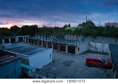 Chomutov, Ustecky Kraj, Czech Republic - May 24, 2017: Sunrise Over Garages And Route 13 In Spring