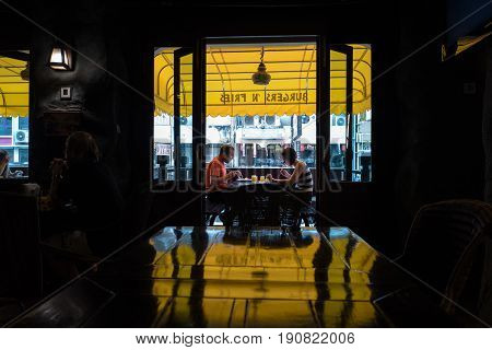 BANGKOK, THAILAND - FEBRUARY 24, 2016 : Breakfast at Khao San road in Bangkok. This is a world famous backpacker street and a major tourist attraction in Thailand.