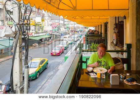 BANGKOK, THAILAND - FEBRUARY 24, 2016 : Morning breakfast at Khao San road in Bangkok. This is a world famous backpacker street and a major tourist attraction in Thailand.