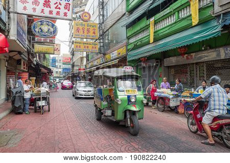 BANGKOK, THAILAND - FEBRUARY 24, 2016: Tuk tuk in Chinatown in Bangkok. Chinatown is a major tourist attraction in Bangkok famous for its markets and gold shops..