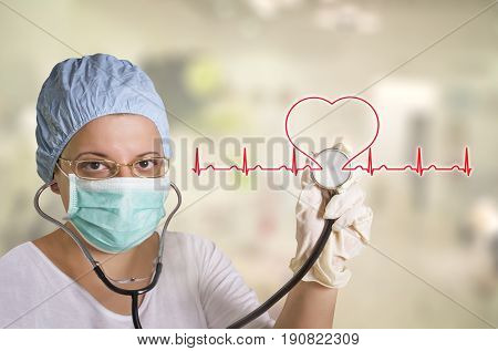 Female doctor with stethoscope listening heart beat