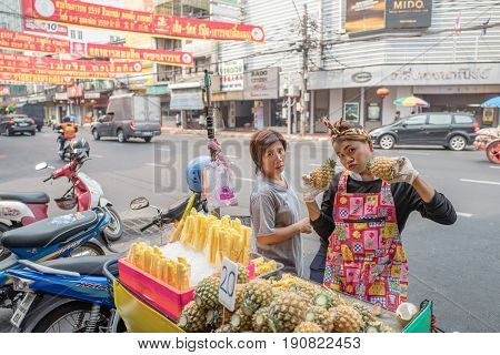 BANGKOK, THAILAND - FEBRUARY 24, 2016: Fruit seller in Chinatown in Bangkok. Chinatown is a major tourist attraction in Bangkok famous for its markets and gold shops..