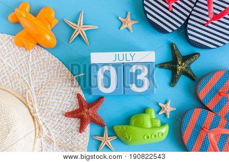July 3rd. Image of july 3 calendar with summer beach accessories and traveler outfit on background. Summer day, Vacation concept.