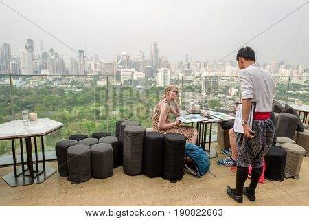 BANGKOK, THAILAND - FEBRUARY 24, 206 : Roof top bar overlooking Lumpini park in Bangkok. Roof top bars are a major tourist attraction in Bangkok.
