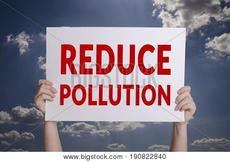 Reduce pollution white card with sky background