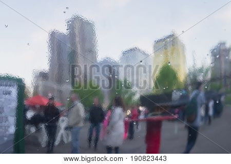Distorted reflection of the city and people on the metal surface, reminiscent of art, watercolor and impressionism. Concept of modern city and lifestyle. Abstract blurred background