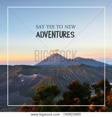 Travel inspirational quotes - say yes to new adventures. Blurry landscape background