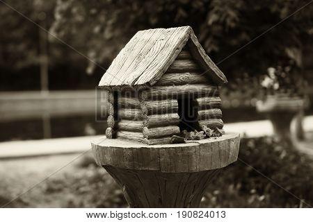 Bird feeder cabin in Russia sepia background h d