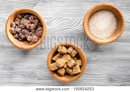 Lumps Of Sugar In Bowls On Gray Table Background Top View