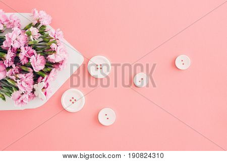 White envelope with pink beautiful flowers on a pink background. mail for you