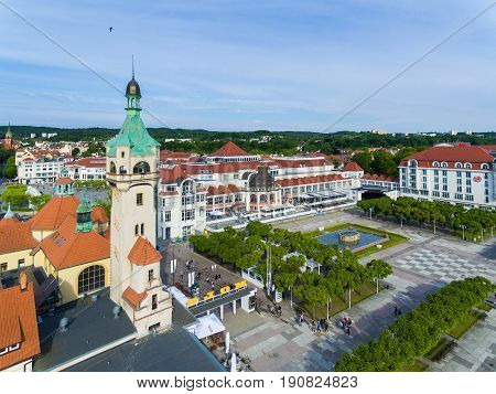 Sopot Poland - June 10 2017: Aerial view of the lighthouse against the Sheraton hotel in the background in morning time