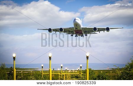 A380 plane taking off from Manchester Airport over Runway Lights