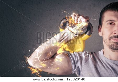 Male athlete lifting kettle bell. Fire illustration.