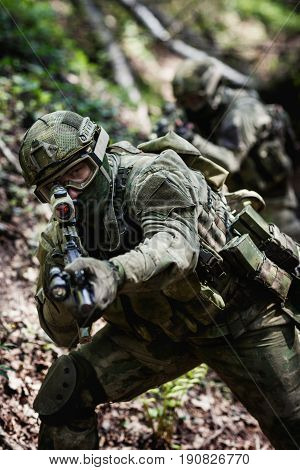 Soldiers exercise in daytime exploration at forest