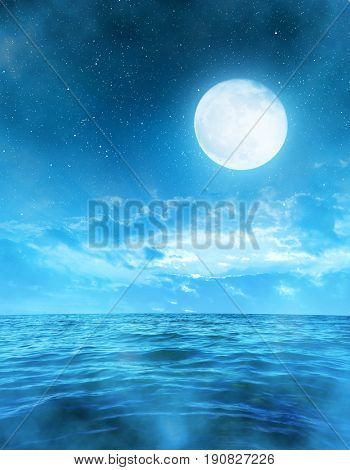 Romantic night sky with full moon above the sea.