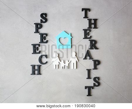 Inscription SPEECH THERAPIST made with  letters on texture background