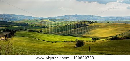 Beautiful and miraculous colors of green spring panorama landscape of Tuscany, Italy.