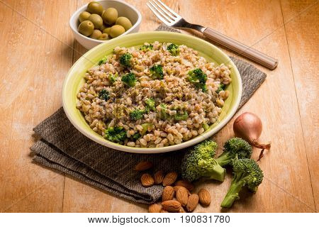 spelt with green olives almond and broccoli