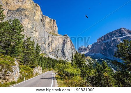 Picturesque road through the Sella Pass, Dolomites. The concept of ecological and extreme tourism. Impressive ridge of dolomite rocks. Autumn in the Tirol