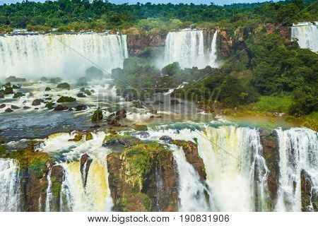 Multistage complex of waterfalls creates strong noise and water dust. Iguazu Falls National Park - waterfalls on the border of Argentina, Brazil and Paraguay