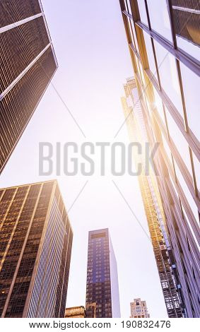 low angle shot of futuristic glass and steel office towers in Manhattan financial district, New York City