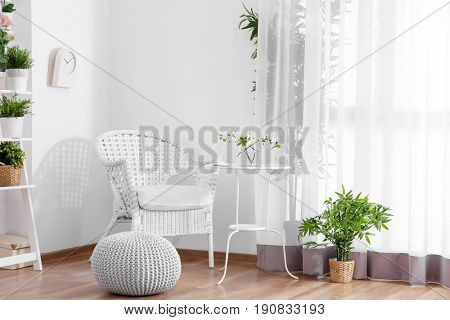 Beautiful modern veranda with cozy furniture and house plants