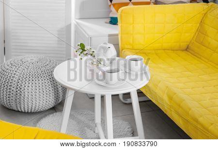 Tea set on table in modern veranda interior