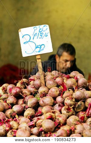 JERUSALEM, ISRAEL - DECEMBER 26, 2016:  beetroot is on the counter in the market of Mahane Yehuda in Jerusalem. More than 250 marketers sell fruits, vegetables, baked products, fish, meat and others