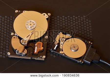 A 3.5 inch desktop and a 2.5 inch laptop hard disk side by side