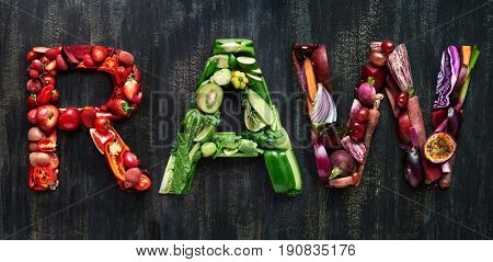 The word raw overhead flatlay word in colourful multi color fruits and vegetables veggies
