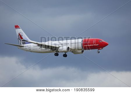 COPENHAGEN, DENMARK - MAY 13, 2016: Airliner of Norwegian Air Shuttle on final approach. Norwegian is the third largest low-cost carrier in Europe