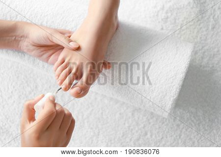 Female legs at pedicure salon