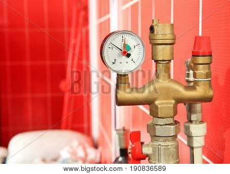 Part of solid fuel boiler with pressure gauge, close up