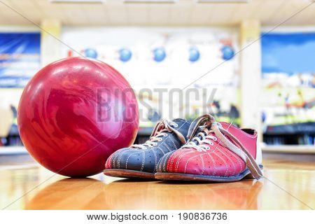 Shoes and ball on floor in bowling club
