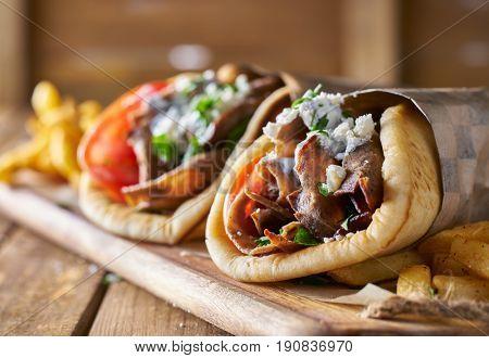 two tasty wrapped greek lamb gyros