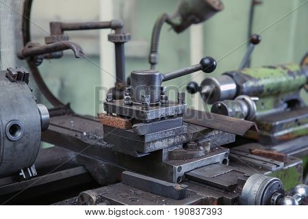Part of turning machine for metalworking in shop, close up