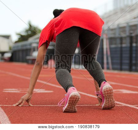Track and field sprinting practice on a red track