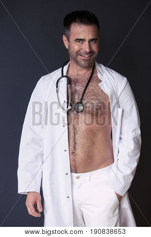 portrait of sexy doctor showing his bare chest