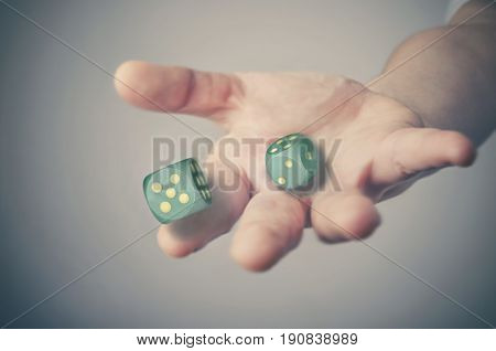 Hand throwing dice. Success or gambling concept.