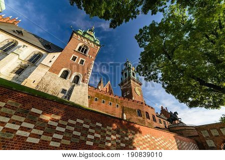Castle towers on Wawel hill in sunny day. Krakow Poland Europe.