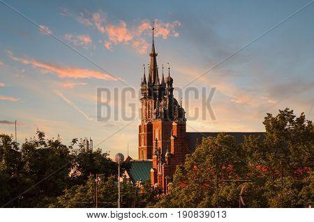 Church of St. Mary on the background of dramatic sky. Basilica Mariacka. Krakow. Poland