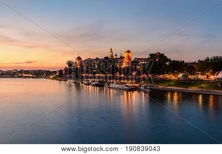 Wawel hill with castle in pink red sunset Krakow Poland Europe.