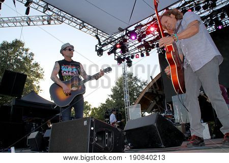 Robin Wilson and Scott Johnson of the Gin Blossoms perform on day 2 of the