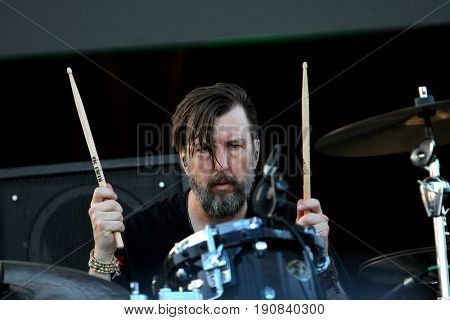 Scott Hessel of the Gin Blossoms performs on day 2 of the