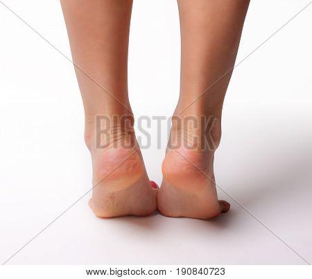 Female slender beautiful legs isolated on white background