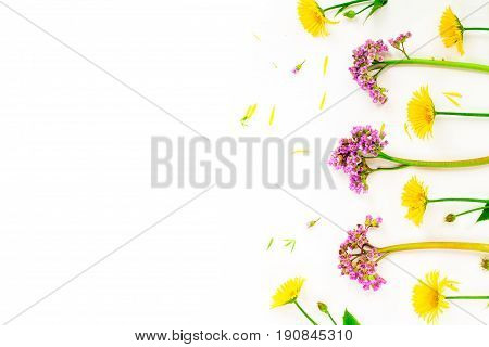 Flowers Composition With Yellow And Pink Spring Flowers On White Background. Copy Space, Flay Lay, T
