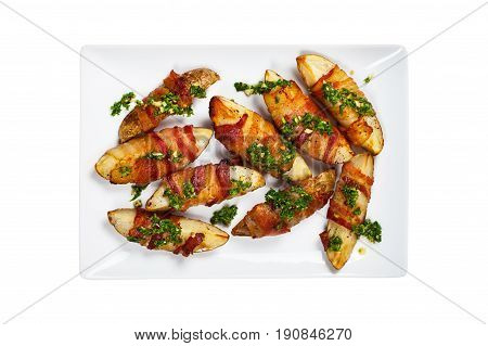 Bacon Wrapped Potatoes Wedges with Parsley Garlic Pesto Sauce Isolated on White background