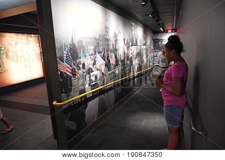 Memphis, TN, USA - June 9, 2017: Young girl in front of exhibit at the National Civil Rights Museum and the site of the Assassination of Dr. Martin Luther King Jr.