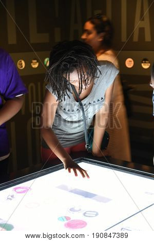 Memphis, TN, USA - June 9, 2017: Young girl in front of interactive exhibit at the National Civil Rights Museum and the site of the Assassination of Dr. Martin Luther King Jr.