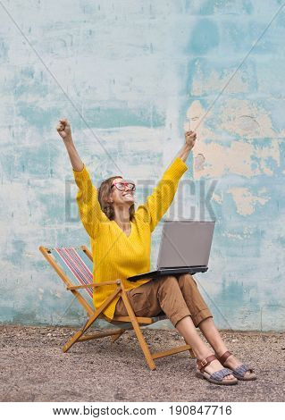 Jubilant girl using a laptop